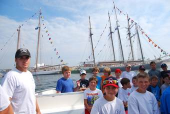 Coastal Discovery kids camp poses with Tall Ships